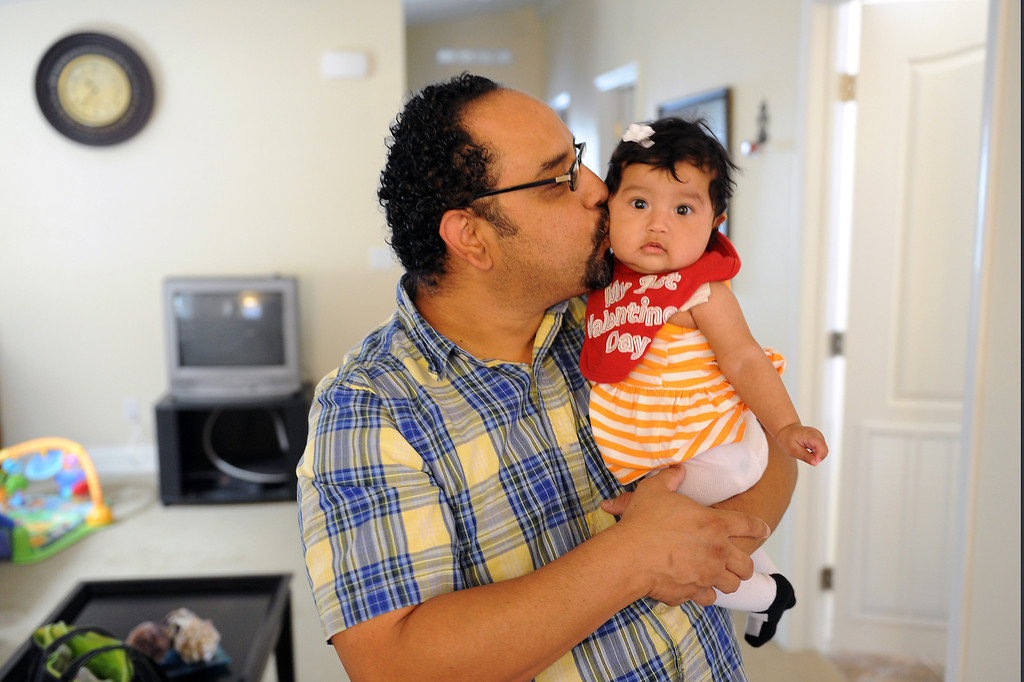 . Andy Mancilla kisses his four-month-old daughter, Andrea Mancilla, in the mobile home they moved into in February at Oakridge Mobile Home Park in Sylmar, Tuesday, April 23, 2013. (Michael Owen Baker/Staff Photographer)