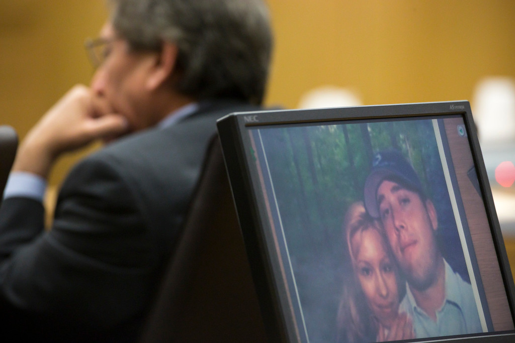 . A photo of Jodi Arias and her former boyfriend, Travis Alexander on a computer screen during the sentencing phase of the Jodi Arias retrial at Maricopa County Superior Court, Tuesday, Feb. 24, 2015 in Phoenix. (AP Photo/The Arizona Republic, Mark Henle, Pool)