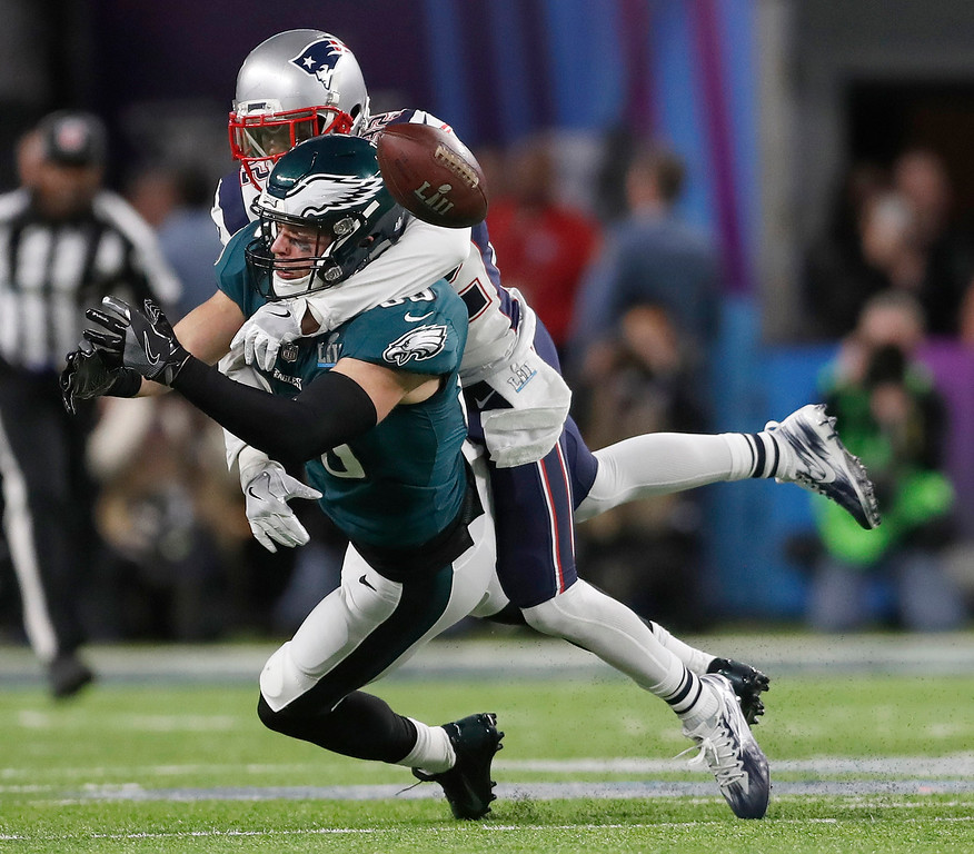 . New England Patriots\' Devin McCourty, top, breaks up a pass intended for Philadelphia Eagles\' Zach Ertz during the first half of the NFL Super Bowl 52 football game Sunday, Feb. 4, 2018, in Minneapolis. (AP Photo/Jeff Roberson)