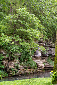 Verticle of canyon walls with stream of water