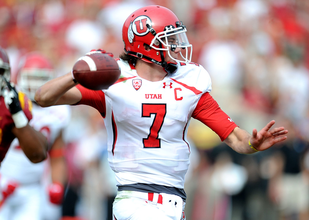 . Utah quarterback Travis Wilson (7) passes against Southern California during the second half of an NCAA college football game in the Los Angeles Memorial Coliseum in Los Angeles, on Saturday, Oct. 26, 2013. Southern California won 19-3.   (Photo by Keith Birmingham/Pasadena Star-News)