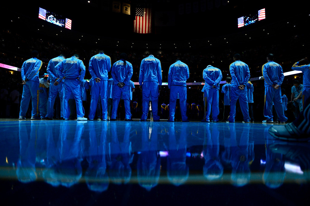 . The Denver Nuggets stand for the National Anthem during the first half at the Pepsi Center on Wednesday, December 26, 2012. AAron Ontiveroz, The Denver Post