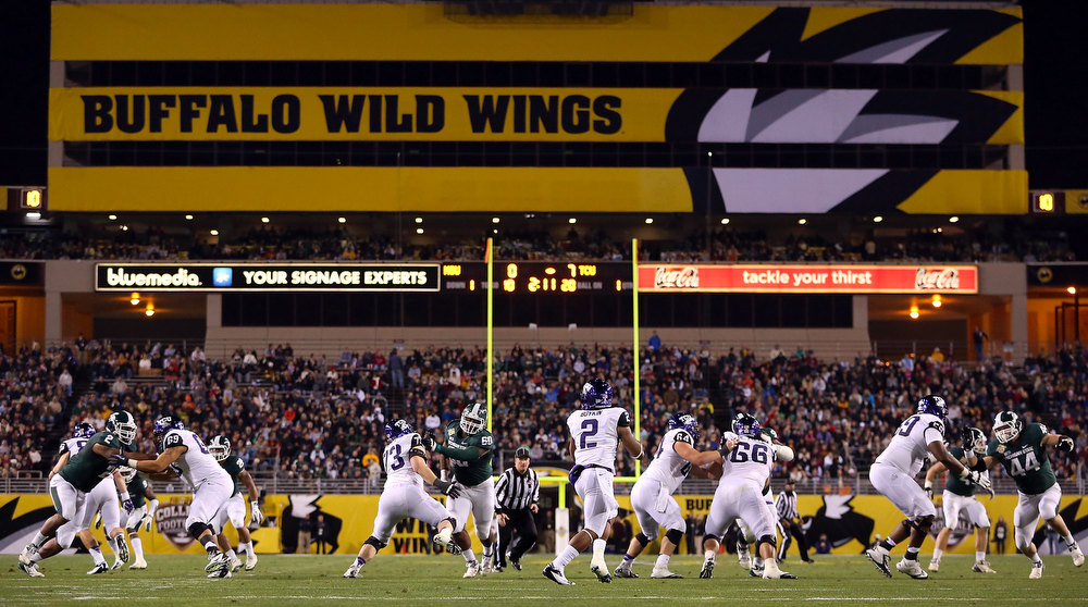 Description of . Quarterback Trevone Boykin #2 of the TCU Horned Frogs drops back to pass during the Buffalo Wild Wings Bowl against the Michigan State Spartans at Sun Devil Stadium on December 29, 2012 in Tempe, Arizona.  (Photo by Christian Petersen/Getty Images)