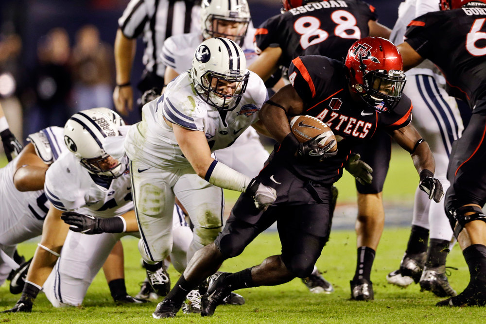 . San Diego State running back Adam Muema rushes against BYU for a first down during the first half of the Poinsettia Bowl NCAA college football game, Thursday, Dec. 20, 2012, in San Diego. (AP Photo/Lenny Ignelzi)