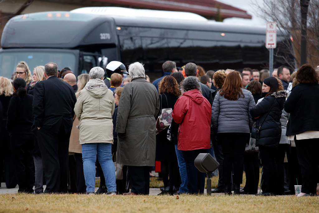 . A crowd of mourners gathers outside of St. Paul the Apostle Catholic Church in Westerville, Ohio before funeral services for Westerville police officers Anthony Morelli and Eric Joering on Friday, Feb. 16, 2018. The two veteran officers were shot after entering a residence Saturday, Feb. 10.  The officers returned fire, wounding 30-year-old Quentin Smith, who has been charged with aggravated murder and remains hospitalized. (AP Photo/Paul Vernon)