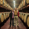 Joe and Lindsay Amidst the Wine Barrels