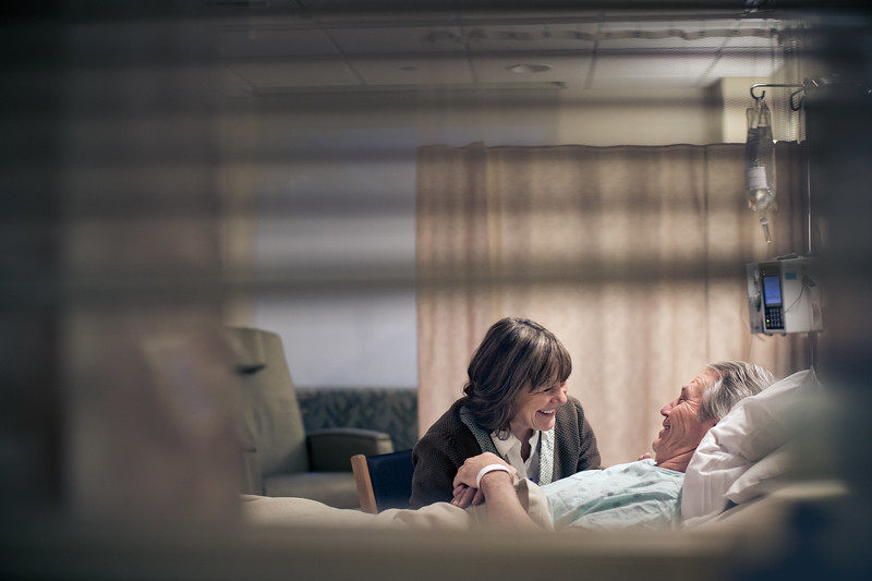 Couple Laughing Together in Husbands Hospital Room