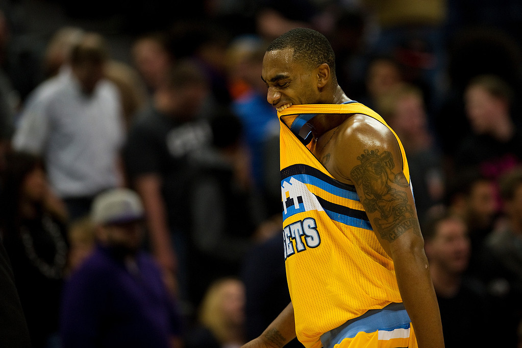 . DENVER, CO - DECEMBER 20: Darrell Arthur #00 of the Denver Nuggets reacts after fouling out in the fourth quarter of an NBA game against the Phoenix Suns at the Pepsi Center on December 20, 2013, in Denver, Colorado. The Suns won 103-99. (Photo by Daniel Petty/The Denver Post)