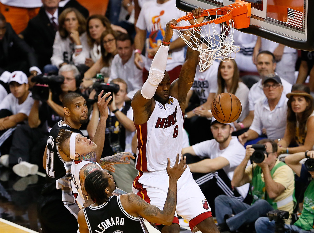 . LeBron James #6 of the Miami Heat dunks the ball against Kawhi Leonard #2 of the San Antonio Spurs in the fourth quarter during Game Six of the 2013 NBA Finals at AmericanAirlines Arena on June 18, 2013 in Miami, Florida. (Photo by Kevin C. Cox/Getty Images)