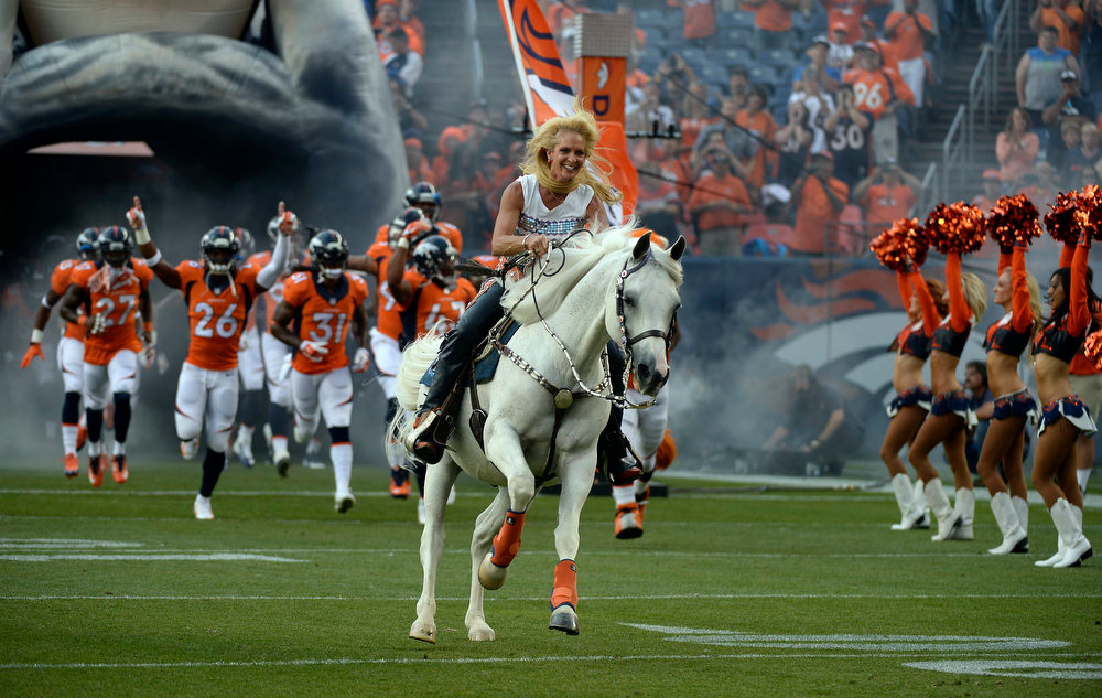 . The Broncos mascot Thunder ridden by Ann Judge-Wegener charges on to the field prior to the start of the game.  The Denver Broncos vs the Seattle Seahawks At Sports Authority Field at Mile High. (Photo by John Leyba/The Denver Post)