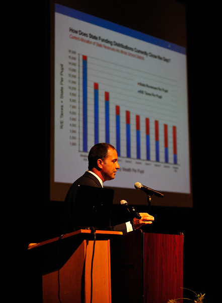 Dr. Robert Grossi, Bloom Treasurer and President, Crystal Financial Consultants, Inc. presents an overview of Senate Bill 16 to parents and educators of District 230 at Orland Park High School, Thursday, October 23rd, 2014, in Orland Park. | Gary Middendorf/for Sun-Times Media