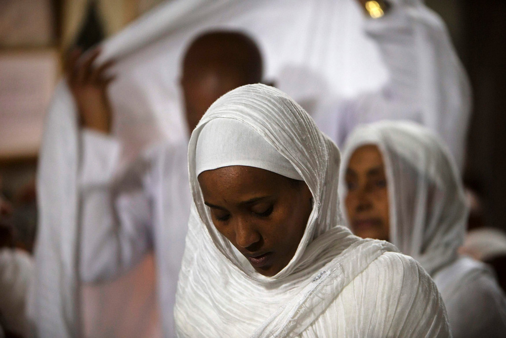 . An Ethiopian Orthodox worshipper prays during the washing of the feet ceremony at the Ethiopian section of the Church of the Holy Sepulchre in Jerusalem\'s Old City May 2, 2013, ahead of Orthodox Easter. REUTERS/Ronen Zvulun