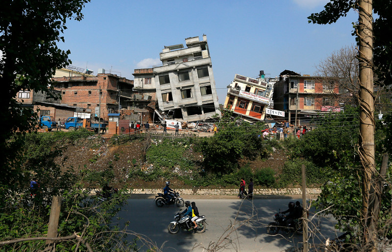. Damaged buildings lean to their sides in Kathmandu, Nepal, Monday, April 27, 2015. A strong magnitude 7.8 earthquake shook Nepal\'s capital and the densely populated Kathmandu Valley on Saturday, causing extensive damage with toppled walls and collapsed buildings. (AP Photo/Wally Santana)