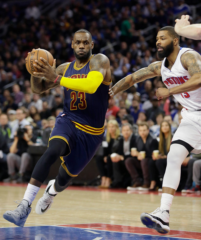 . Cleveland Cavaliers forward LeBron James (23) drives on Detroit Pistons forward Marcus Morris (13) during the first half in Game 4 of a first-round NBA basketball playoff series, Sunday, April 24, 2016 in Auburn Hills, Mich. (AP Photo/Carlos Osorio)