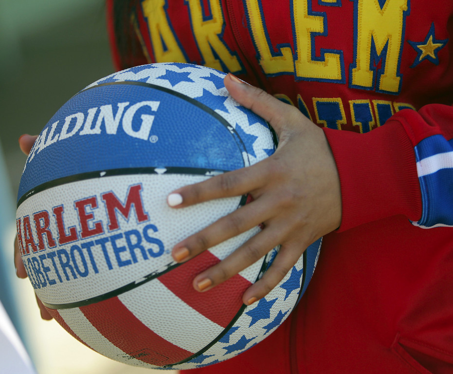 . Harlem Globetrotters� rookie and Oakland native Tammy �T-Time� Brawner holds a team basketball during a visit to Laurel Elementary School in Oakland, Calif., on Wednesday, Jan. 16, 2013. (Anda Chu/Staff)