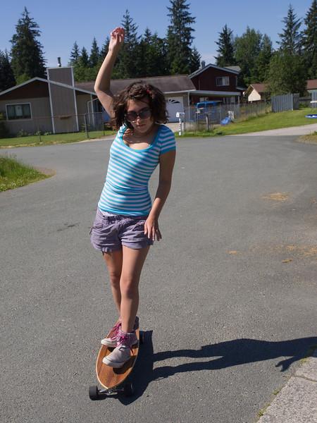 Elia on her new longboard.