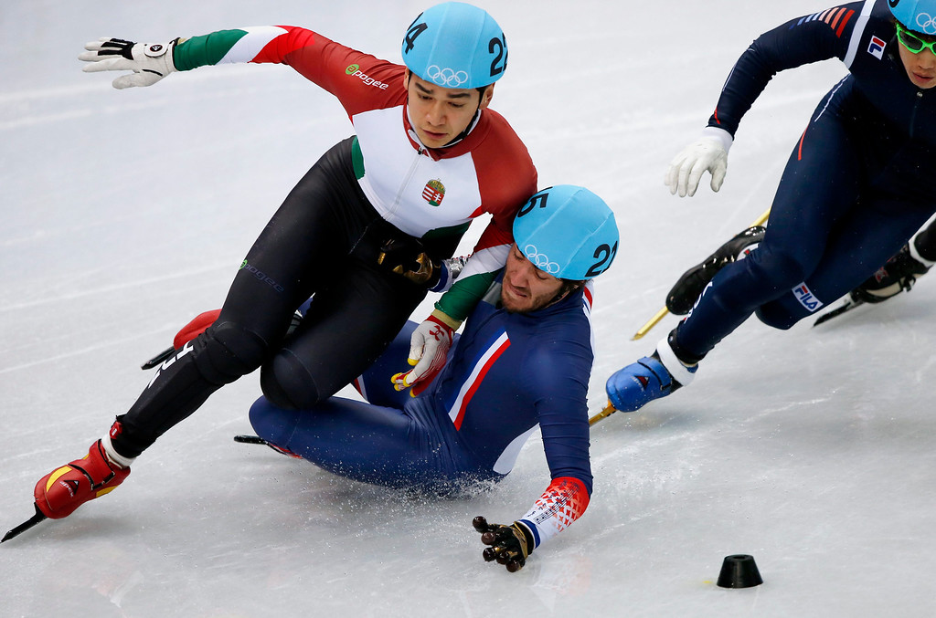 . Thibaut Fauconnet of France collides with Hungary\'s Sandor Liu Shaolin (L) in Heat 8 in the men\'s 1000m of the Short Track competitions in the Iceberg Skating Palace at the Sochi 2014 Olympic Games, Sochi, Russia, 13 February 2014.  EPA/BARBARA WALTON