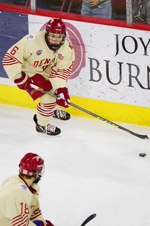 . Denver Pioneers defenseman Matt VanVoorhis (6) moves the puck down ice during the first period at Magness Arena on March 4, 2016 in Denver, Colorado. (Photo by Brent Lewis/The Denver Post)