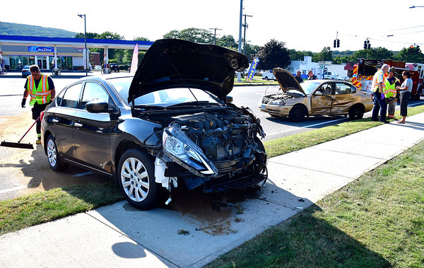 8/15/2019 Mike Orazzi | Staff The scene of a two-car crash on Middle Street near Battista Road, two were transported from the scene.