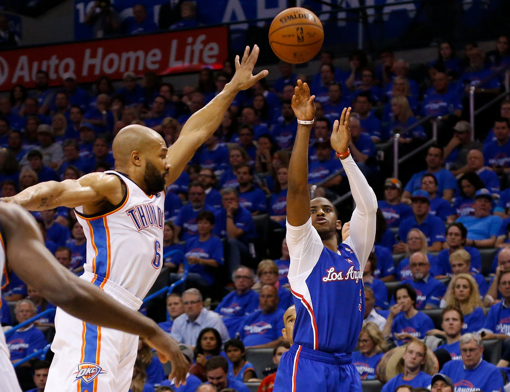 . Los Angeles Clippers guard Chris Paul (3) shoots in front of Oklahoma City Thunder guard Derek Fisher (6) in the second quarter of Game 1 of the Western Conference semifinal NBA basketball playoff series in Oklahoma City, Monday, May 5, 2014.   Los Angeles won 122-105.  (AP Photo/Sue Ogrocki)