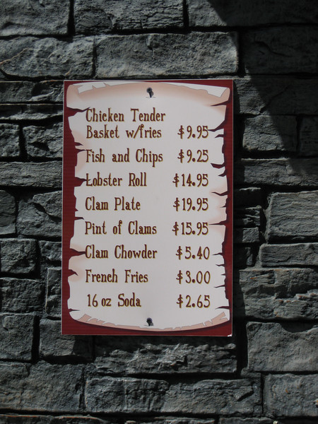 A new Minuteman Fried Clams menu sign.