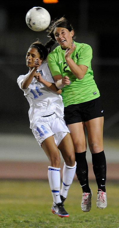 . Quartz Hill #11Crystal Crump and  #22 Morgan Mullin battle for the ball. The Girls from Quartz Hill defeated South Torrance in a sudden death overtime in a Southern Section Division IV Semifinal soccer game. Quartz Hills, CA 2/23/2013(John McCoy/Staff Photographer)