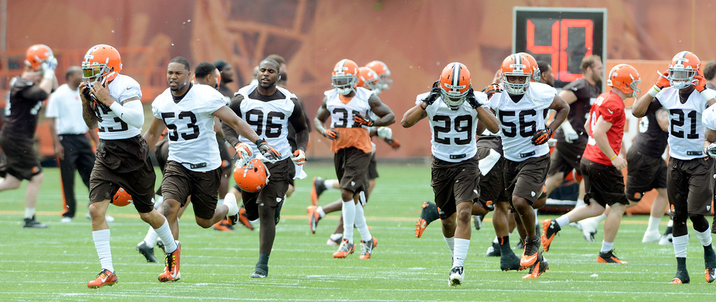 . Maribeth Joeright/MJoeright@News-Herald.com <p> Browns players prepare to begin their practice during mini camp in Berea, June 10, 2014.