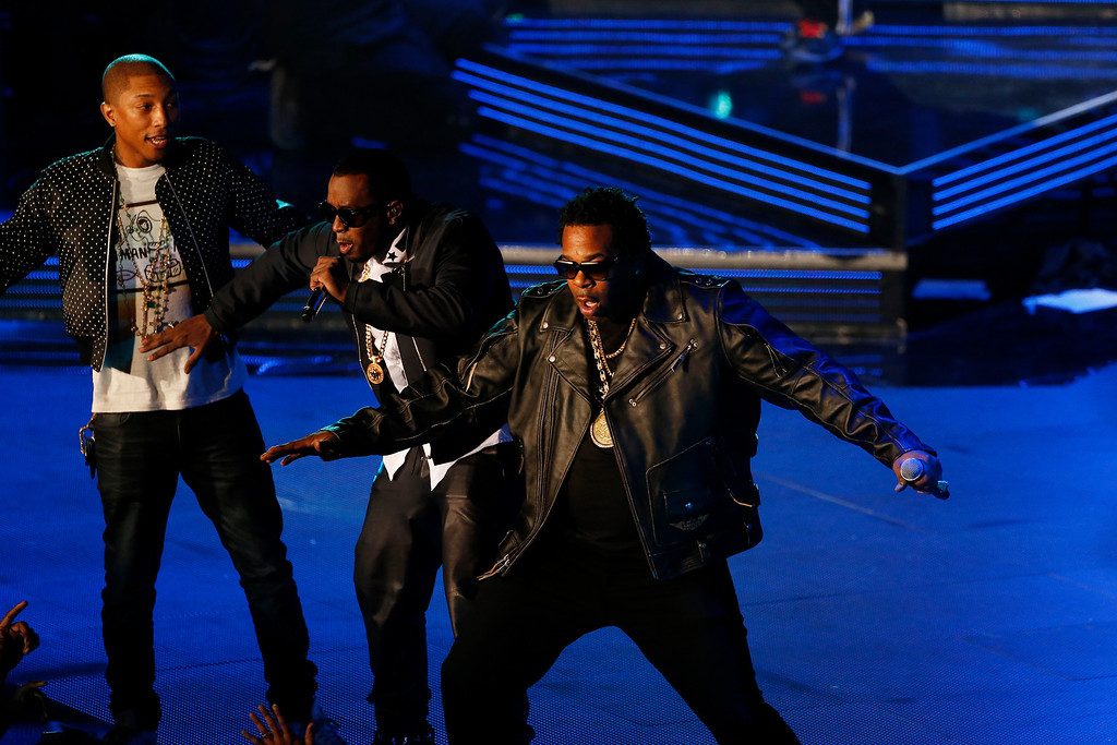 . Rappers P Diddy, center, Pharrell Williams, left, and Busta Rhymes perform during the NBA All Star basketball game, Sunday, Feb. 16, 2014, in New Orleans (AP Photo/Bill Haber)
