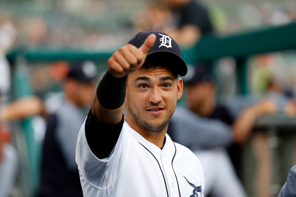 . Detroit Tigers shortstop Jose Iglesias give s thumbs up in the dugout against the Cleveland Indians before a baseball game in Detroit, Friday, July 27, 2018. (AP Photo/Paul Sancya)
