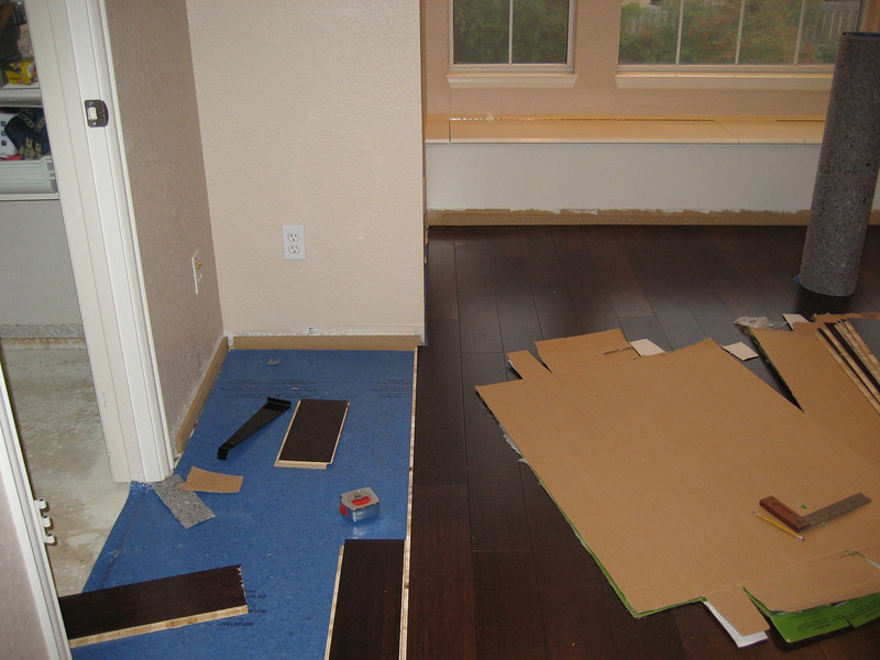 Laying flooring in main room up to the closet.