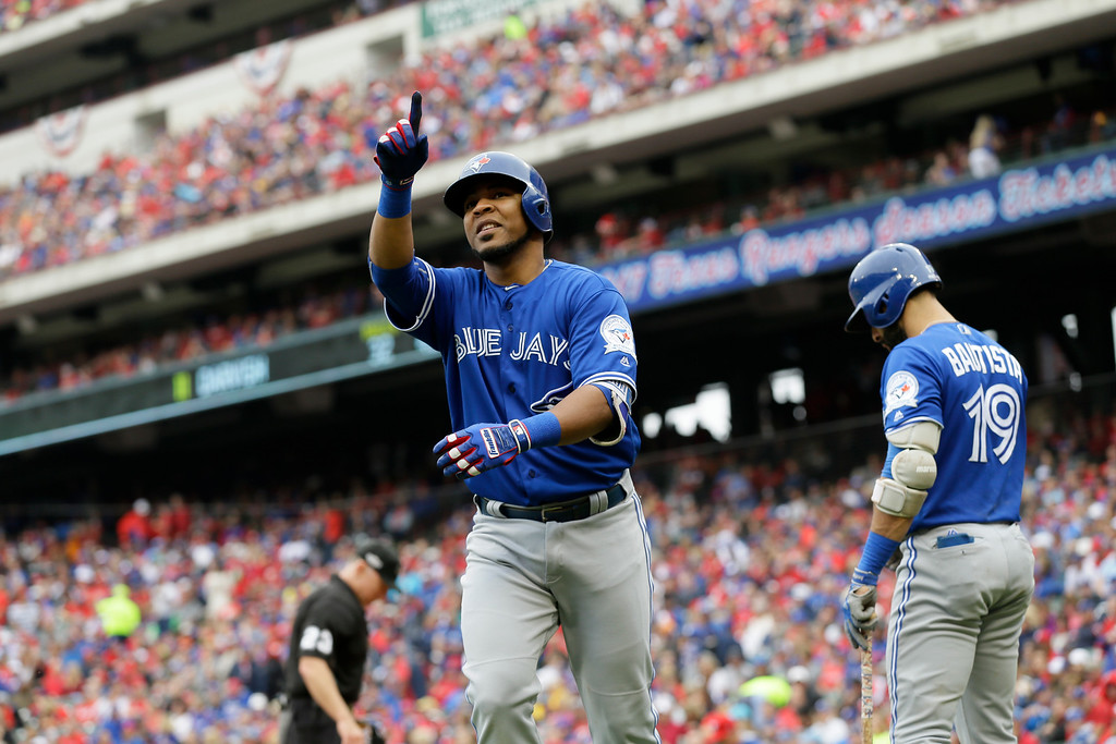 . Toronto Blue Jays\' Edwin Encarnacion celebrates his solo home run off a pitch from Texas Rangers\' Yu Darvish in the fifth inning of Game 2 of baseball\'s American League Division Series, Friday, Oct. 7, 2016, in Arlington, Texas. (AP Photo/LM Otero)
