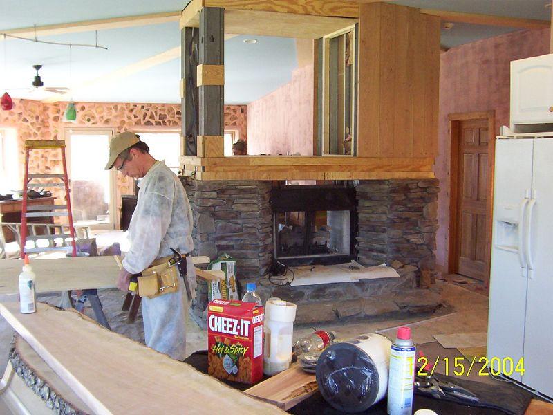 Beemer John working on paneling.