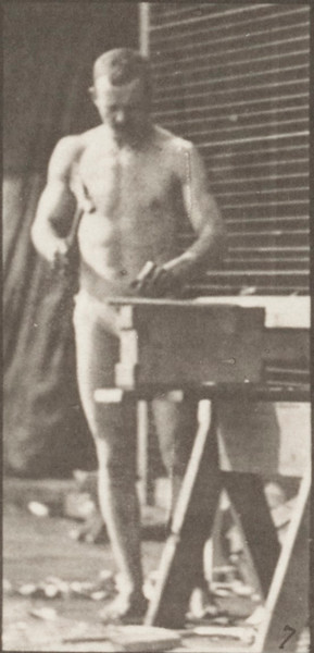 Man in pelvis cloth carpentering