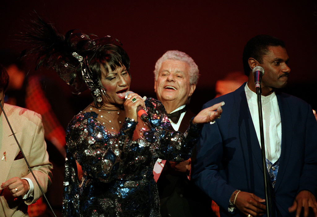 . Queen of salsa Celia Cruz, left, performs with Latin jazz percussionist and bandleader Tito Puente, center, during an all-star concert before a capacity crowd at Madison Square Garden in New York City, late Saturday night, Oct. 22, 1994.  Cruz celebrated her 68th birthday at the concert.  (AP Photo/L.M. Otero)
