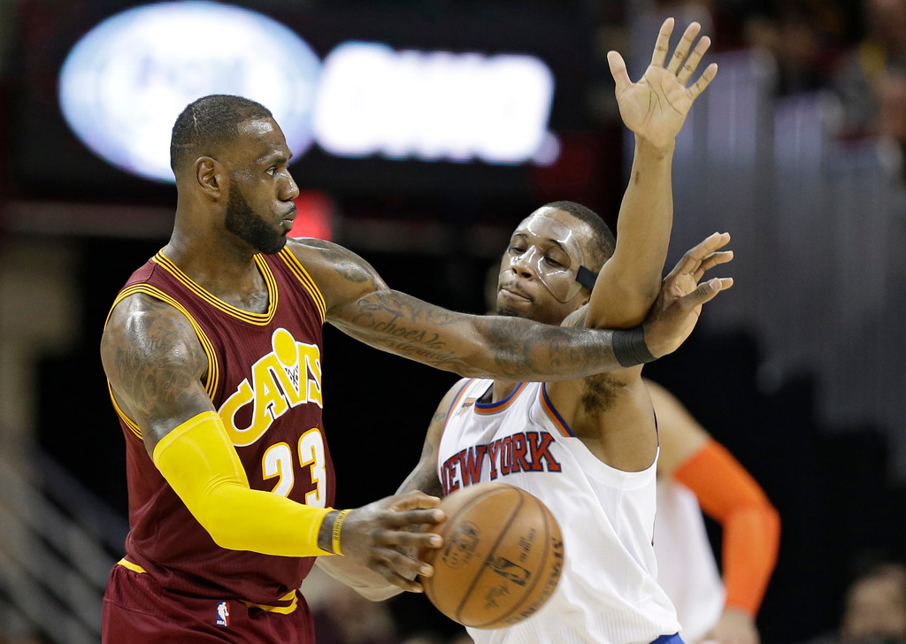 . Cleveland Cavaliers\' LeBron James, left, passes against New York Knicks\' Lance Thomas in the second half of an NBA basketball game, Thursday, Feb. 23, 2017, in Cleveland. The Cavaliers won 119-104.(AP Photo/Tony Dejak)