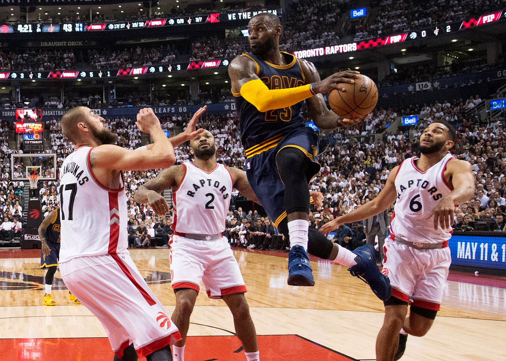 . Cleveland Cavaliers forward LeBron James (23) drives to the basket past Toronto Raptors center Jonas Valanciunas (17), Raptors forward PJ Tucker (2) and Raptors guard Cory Joseph (6) during the first half of Game 3 of an NBA basketball second-round playoff series in Toronto on Friday, May 5, 2017. (Frank Gunn/The Canadian Press via AP)
