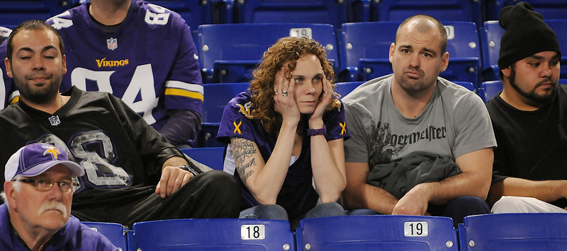. Dejected Vikings fans watch the final minutes of the game. (Pioneer Press: John Autey)