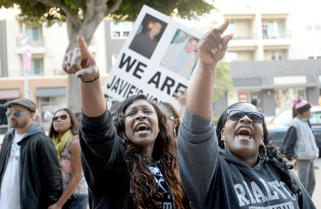 . Ty Woods, 25, left, and Shala Woods, aunts of Tyler Woods, who was shot by the Long Beach Police Department on November 19, protest his shooting death outside the department headquarters in Long Beach on Sunday, November 24, 2013. (Photo by Sean Hiller/ Daily Breeze).