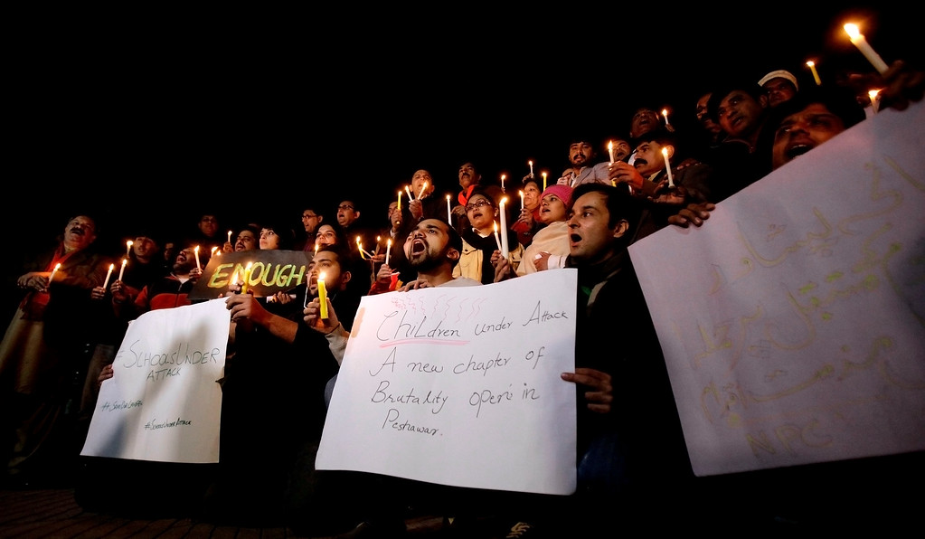 . Pakistani journalists and civil society members hold a candle light vigil for the victims of a Taliban attack on a school, in Islamabad, Pakistan, Tuesday, Dec. 16, 2014. Taliban gunmen stormed a military-run school in the northwestern Pakistani city of Peshawar on Tuesday, killing more than 100, officials said, in the highest-profile militant attack to hit the troubled region in months. (AP Photo/Anjum Naveed)