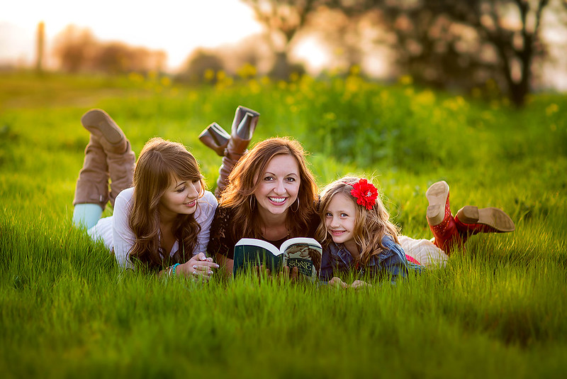 Sacramento family photographer during outdoor portrait session. Spring Family portrait in a park.