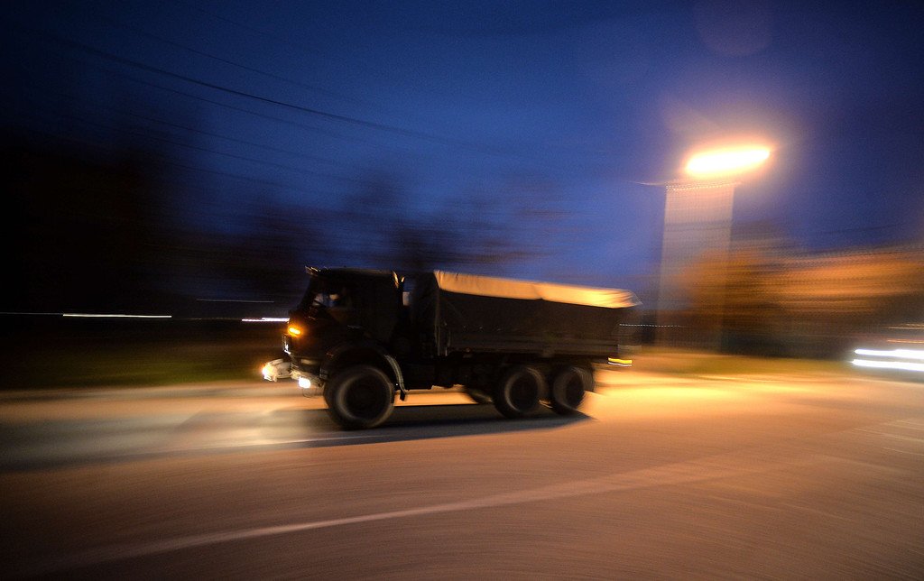 . Russian military vehicles drive on the main road entering Sevastopol on March 11, 2014. Pro-Moscow lawmakers in Crimea voted for independence from Ukraine on March 11 in a precursor to a referendum this weekend for the region to become part of Russia.  FILIPPO MONTEFORTE/AFP/Getty Images
