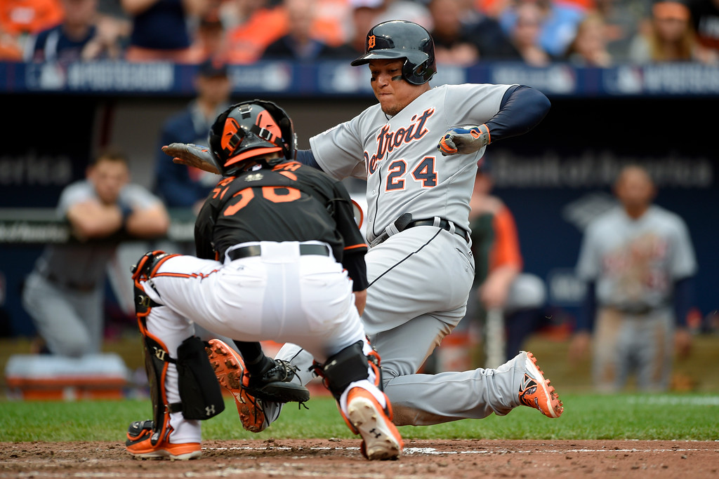 . Baltimore Orioles catcher Caleb Joseph tags out Detroit Tigers\' Miguel Cabrera at home plate on Detroit Tigers designated hitter Victor Martinez\'s double in the eighth inning of Game 2 in baseball\'s AL Division Series in Baltimore, Friday, Oct. 3, 2014. Baltimore won 7-6. (AP Photo/Nick Wass)