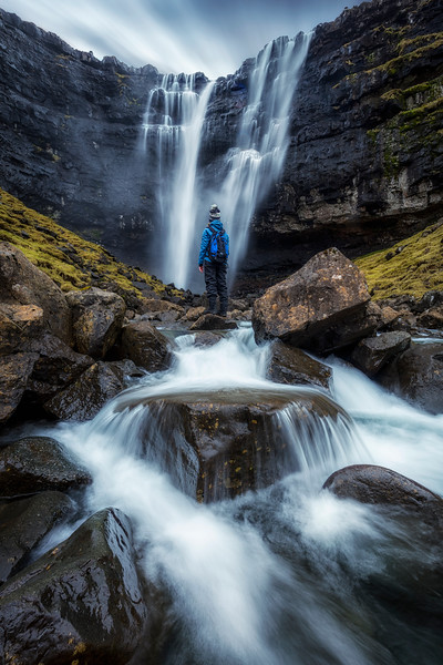 Fossa waterfall faroe islands long exposure person travel.jpg