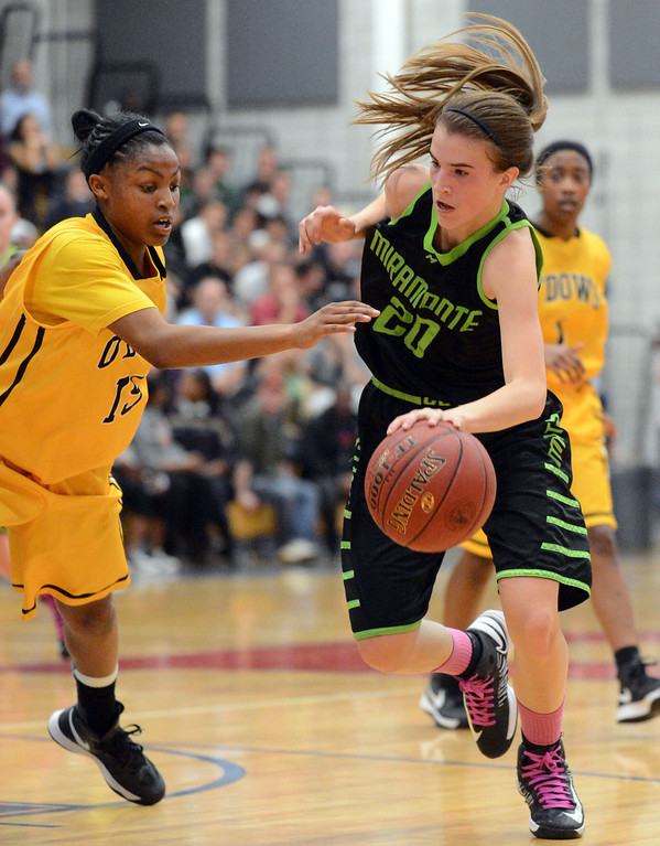 . Bishop O\'Dowd High\'s Aisia Robertson (15) left, tries to steal the ball from Miramonte High\'s Sabrina Ionescu (20) in the forth period of their Division III North Coast Section basketball game in Dublin, Calif., on Saturday, March 2, 2013. Bishop O\'Dowd High went on to win the game 77-48. (Doug Duran/Staff)