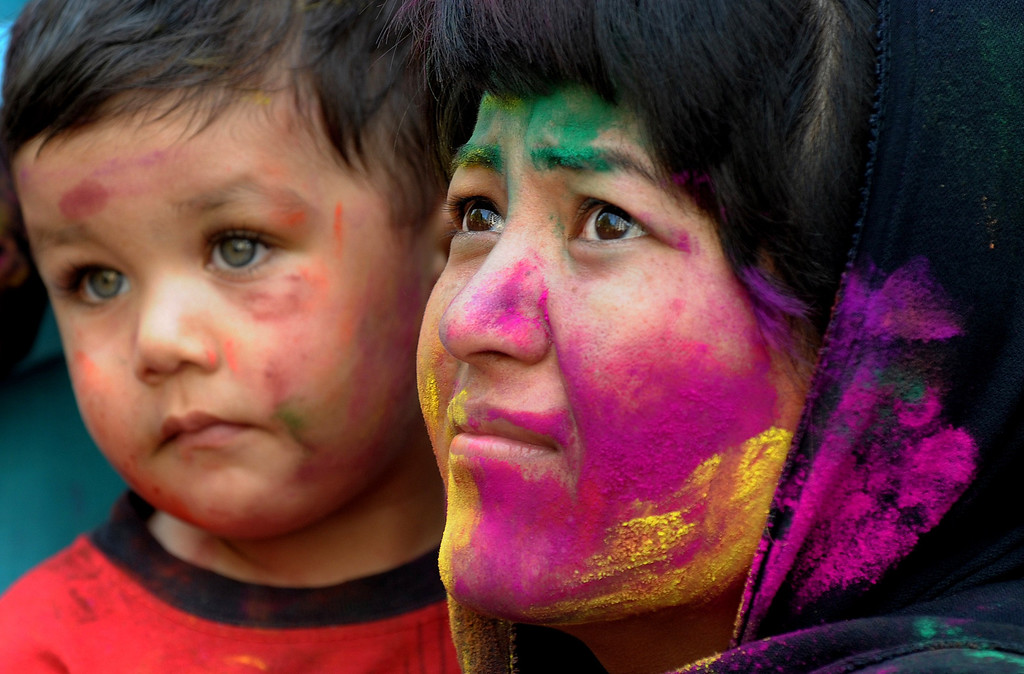 . Students of English and Foreign Languages University (EFL) gesture during Holi celebrations in Hyderabad on March 17, 2014. Holi, also called the Festival of Colors, is a popular Hindu spring festival observed in India at the end of the winter season on the last full moon day of the lunar month. AFP PHOTO/Noah SEELAM/AFP/Getty Images