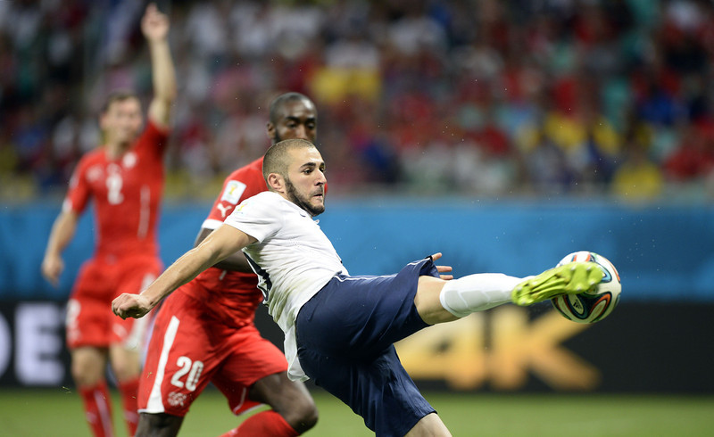 . France\'s forward Karim Benzema (front C) kicks to score his team\'s fourth goal during a Group E football match between Switzerland and France at the Fonte Nova Arena in Salvador during the 2014 FIFA World Cup on June 20, 2014. (FRANCK FIFE/AFP/Getty Images)