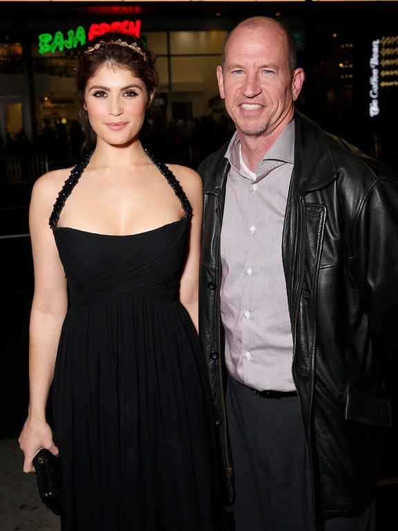 """. Gemma Arterton and Vice Chairman of Paramount Pictures Corporation Rob Moore arrive at the premiere of \""""Hansel & Gretel Witch Hunters\"""" on Thursday Jan. 24, 2013, in Los Angeles.  (Photo by Todd Williamson/Invision/AP)"""