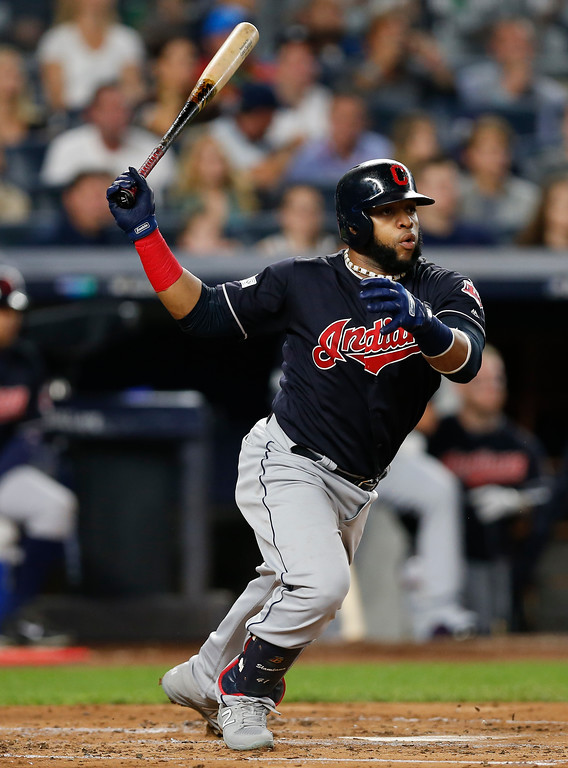 . Cleveland Indians\' Carlos Santana connects for a base hit against the New York Yankees during the second inning in Game 3 of baseball\'s American League Division Series, Sunday, Oct. 8, 2017, in New York. (AP Photo/Kathy Willens)