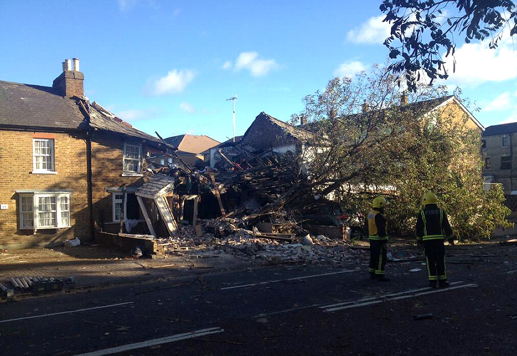 . A handout picture from the London Fire Brigade shows fire fighters standing outside three houses collapsed in a gas explosion suspected to have been caused by a gas main damaged by a falling tree following a fierce storm in Hounslow, west London, on October 28, 2013. More than 300,000 homes were left without power across northern Europe and trains and planes cancelled as a fierce storm battered the region, leaving at least three people dead. AFP PHOTO / LONDON FIRE BRIGADE /AFP/Getty Images