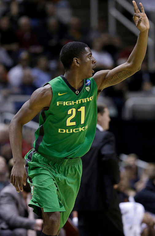 . Oregon guard Damyean Dotson (21) gestures after making a three-point basket against Oklahoma State during the first half of a second-round game in the NCAA college basketball tournament in San Jose, Calif., Thursday, March 21, 2013. (AP Photo/Jeff Chiu)
